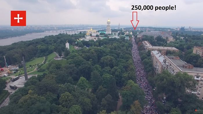 "The 2018 Canonical procession. The photo is taken from the north looking south towards the Lavra. The colossal statue ""the motherland"" is visible in the background also on the left, farther from the Lavra."
