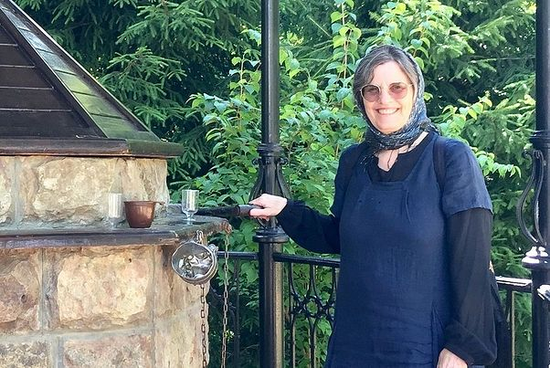 Martha Nichols, a spiritual child of Fr. Seraphim, at the well at the Skete of St. John the Forerunner at the Optina Hermitage