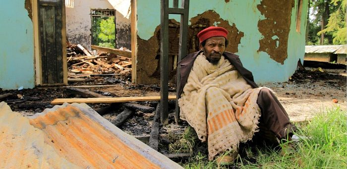A member of the Ethiopian Tewahedo Church sits in front of the destroyed Doya St. Michael Church, Southern region, Sidama district, July 2019. Credit: Courtesy of Tewodrose Tirfe/Amahara Association of America