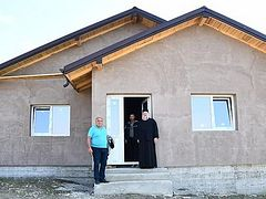 Romanian monastery building house for family with 10 children