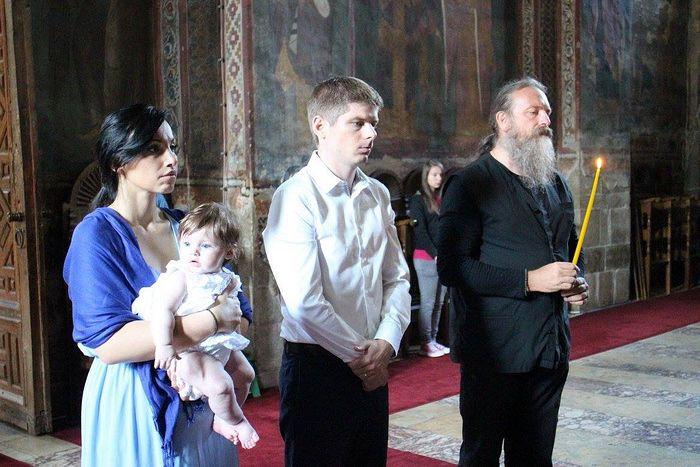 During daughter's baptism at the Visoki Dečani monastery.