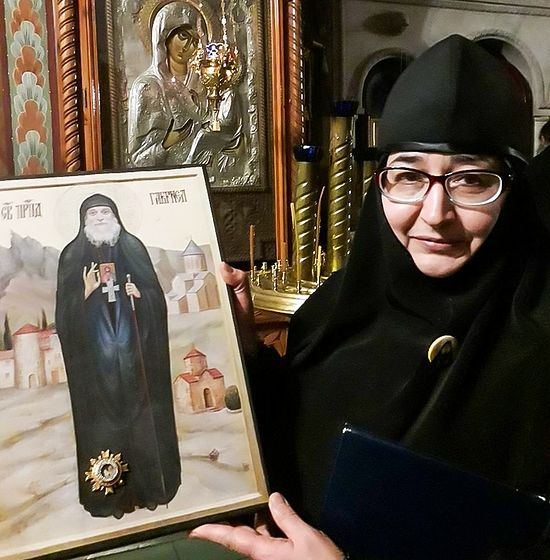 Novice Nun Maria (Glushchenko) with the icon of Elder Gabriel (Urgebadze)