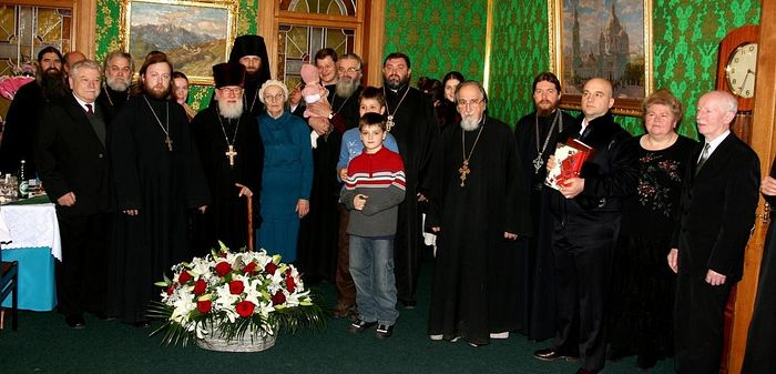 Fr. Matthew with family, loved ones, and friends. Then-Archimandrite Tikhon (Shevkunov), now Metropolitan of Pskov, stands on the right near the picture of Theophany Cathedral.