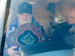Metropolitan of Minsk sprinkles city with holy water from helicopter against coronavirus
