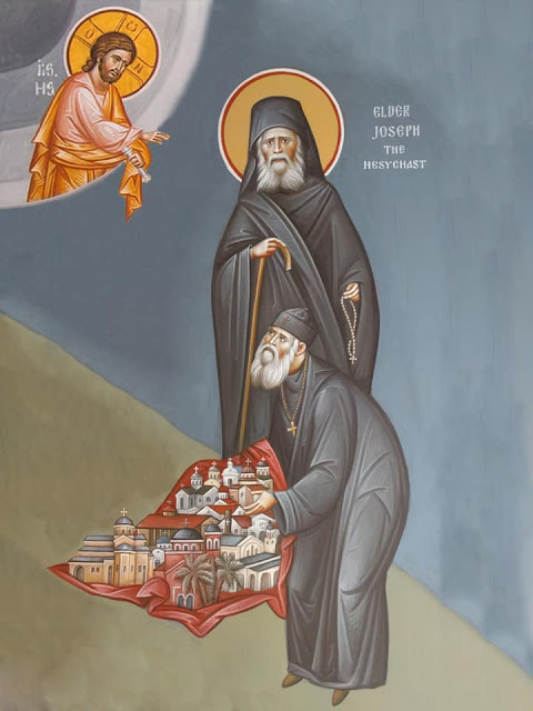 St. Joseph the Hesychast with his disciple Elder Ephraim, holding the monasteries he established in North America. Photo: Twitter