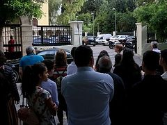 Greek faithful protest closing of churches at Synodal headquarters in Athens
