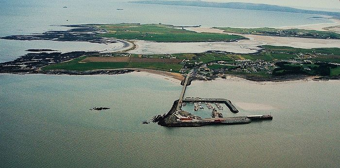 Fenit, St. Brendan's birthplace, with the harbor and island (taken from Wikipedia)