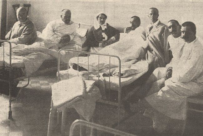 Maria Pavlovna in hospital amongst the wounded.