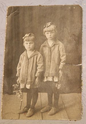 With a sister in her childhood.