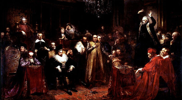 """The Sermon of the Jesuit Peter Skarga (standing preaching on the right) to the Polish """"Jesuit King"""" Sigismund III Vasa, who is seated to the left. Painting by Jan Matejko. Photo: Wikipedia"""