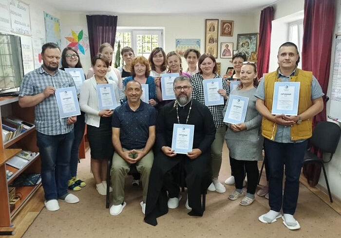 Роман Прищенко и слушатели семинара на вручении сертификатов в Калининграде