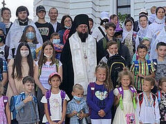 Children from needy families receive school supplies from Ukrainian Church