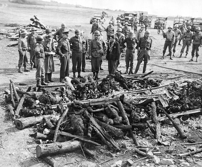 The American generals Patton, Bradly, and Eisenhower at the Ohrdruf concentration camp at the bonfire where the Germans burned the bodies of prisoners