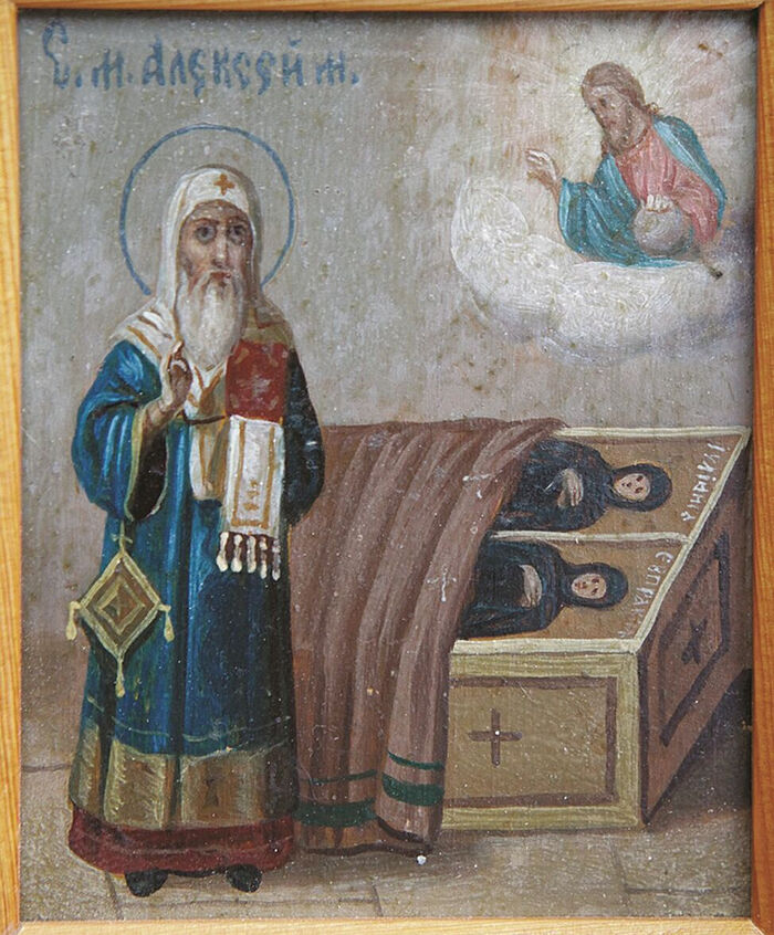 St. Alexei at the grave of his holy sisters Juliana and Eupraxia