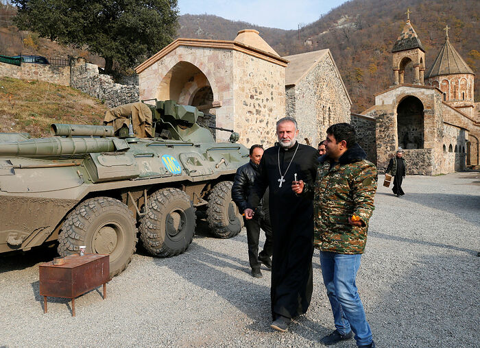 The monastery's abbot Father Hovhannes walks past a military vehicle of the Russian peacekeeping forces at the Dadivank, an Armenian Apostolic Church monastery, located in a territory which is soon to be turned over to Azerbaijan under a peace deal that followed the fighting over the Nagorno-Karabakh region, in the Kalbajar district on Sunday. (Reuters/Stringer)
