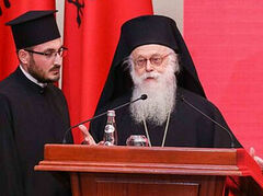Archbishop Anastasios accepts national medal for fostering peace on behalf of Inter-Religious Council