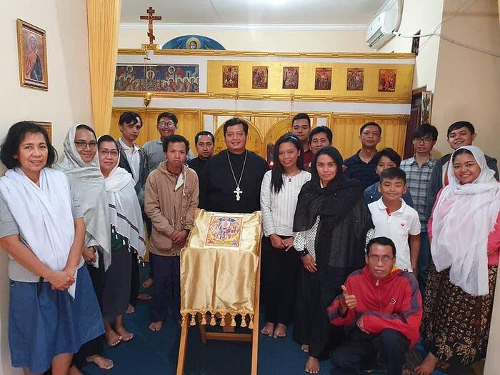 Priest Theodore Yoel with parishioners