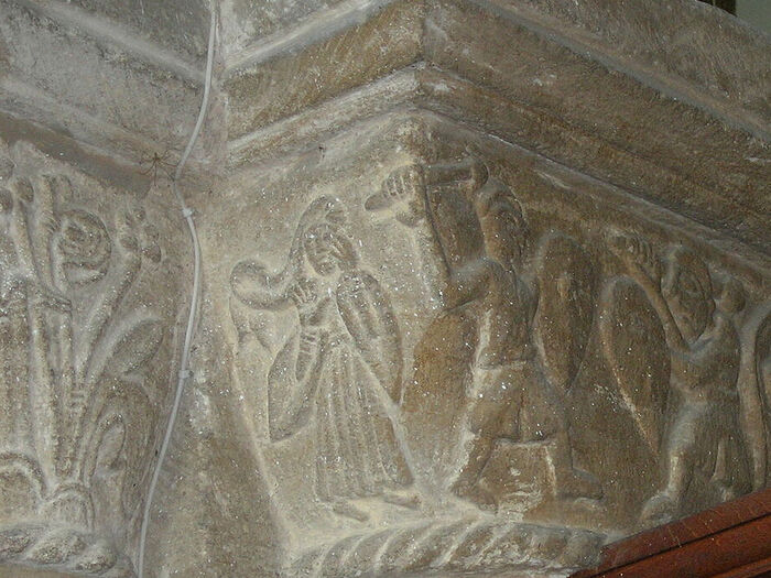 St. Cyneburgh as depicted on a capital of the church in Castor with two warriors pursuing her, Cambs (provided by Dr. Avril Lumley-Prior)