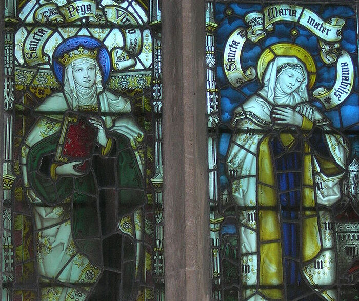 Images of St. Pega and the Mother of God on the east window of the church in Peakirk, Cambs (kindly provided by Dr. Avril Lumley-Prior)