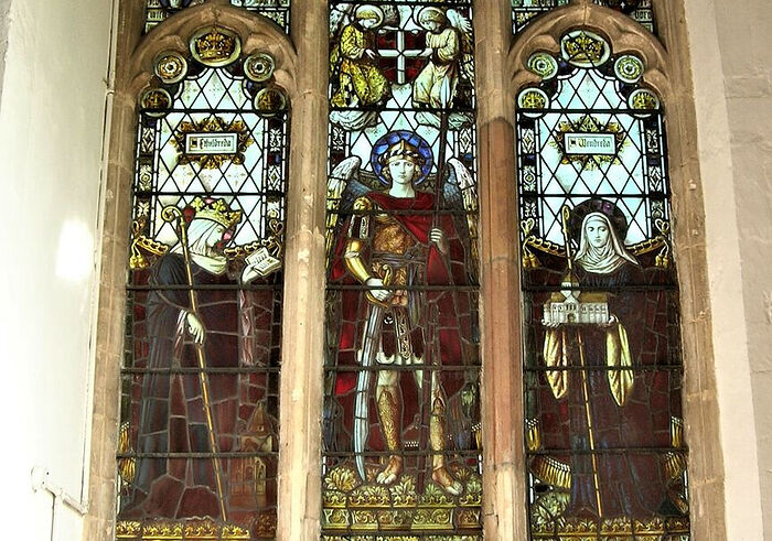St. Etheldreda, the Archangel Michael and St. Wendreda (from left to right) on a window at the church in March (provided by Dr. Avril Lumley-Prior)