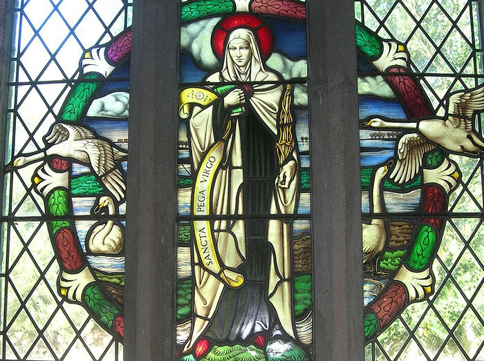 St. Pega depicted on a stained glass window of the north aisle of the church at Peakirk, Cambs (kindly provided by Dr. Avril Lumley-Prior)