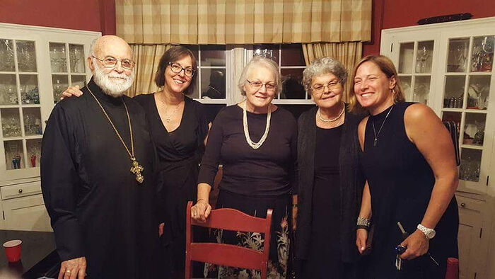 Archpriest George Larin with his family and parishioners