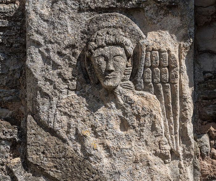 Carving of the angel on the exterior wall of the ruined apse of Deerhurst church (picture is the copyright of Deerhurst Parochial Council)