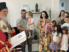 Mother of 10 receives new home and Serbian Church award