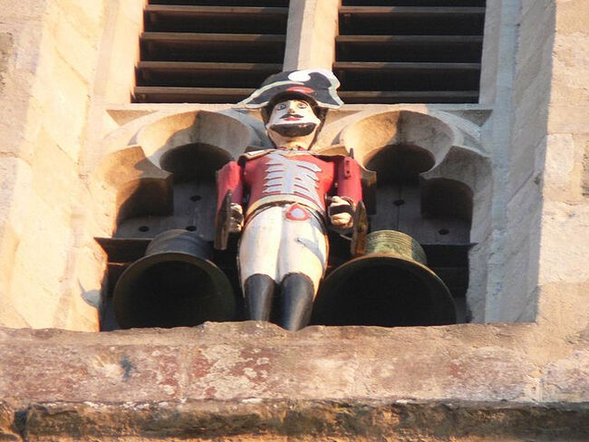 The 'Quarter Jack' painted statue on the west tower of Wemborne Minster Church, Dorset (photo - Wikimedia Commons)