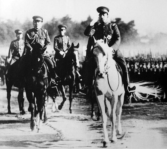 The Japanese Emperor Hirohito inspects the troops.