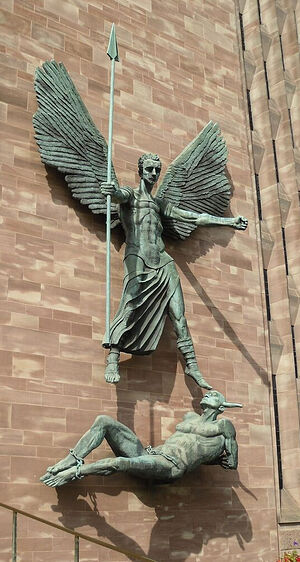 The sculpture of St. Michael vanquishing the devil on the wall of the new cathedral in Coventry. Photo by Irina Lapa