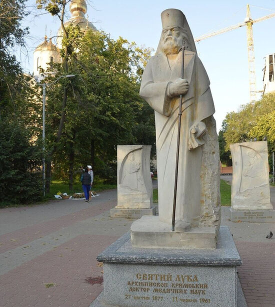 The sculpture of St. Luke of Crimea with bas-reliefs of his parents