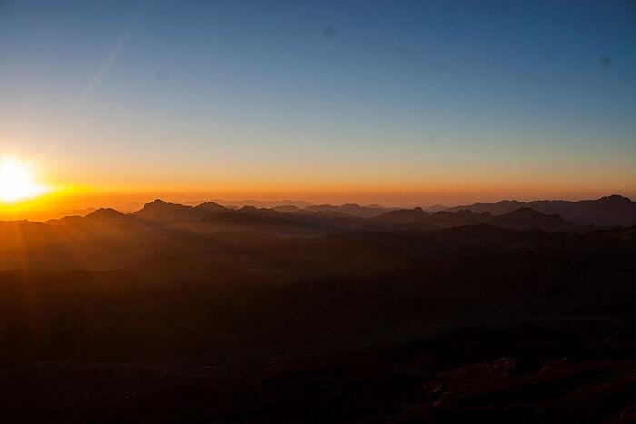 Dawn over Mt. Sinai transforms the whole mountain range