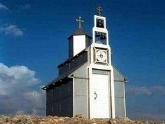 Ethnic Albanians demand removal of church