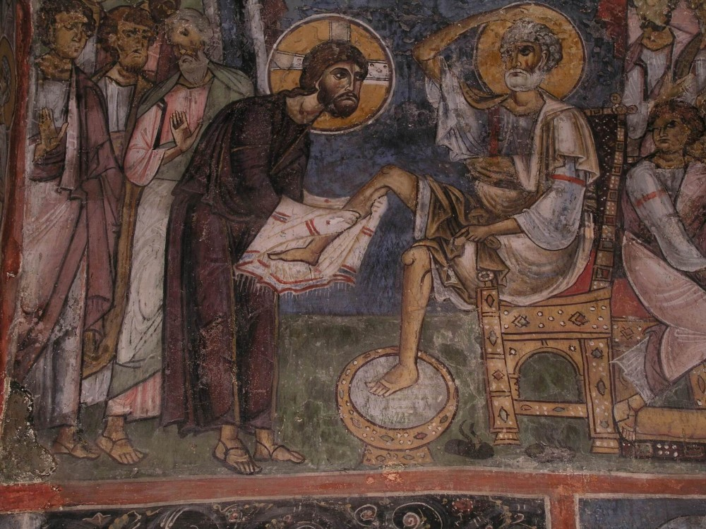 Holy and Great Thursday. Washing the feet of the Apostles. Wall painting of the Panagia Assinou in Nikitari, Cyprus. 1105.